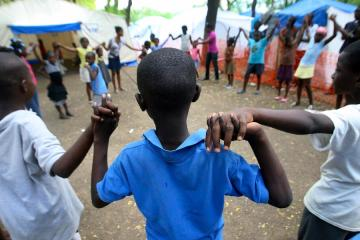 Displaced Haiti Children Find Solace in Camp Play Area